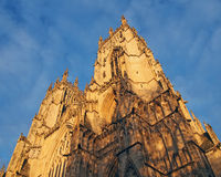 an upwards view of the towers at the front of york minster in sunlight
