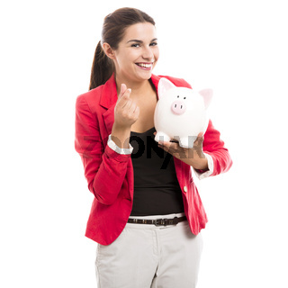 Business woman with a piggy bank