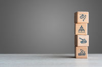 Military equipment wooden block icons on with grey background copy space - Army war battle conflict