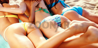 girls sunbathing on the beach