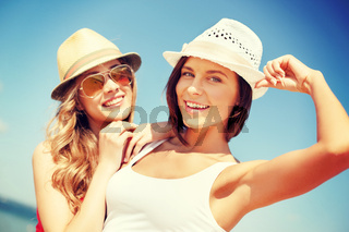 girls in hats on the beach