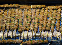 A street food stall in Taiwan offers fresh meat skewers