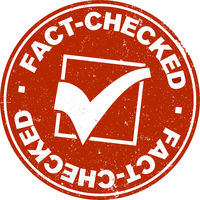 grungy red round FACT-CHECKED label or rubber stamp with checkmark