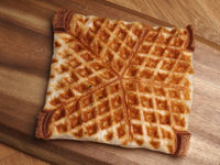 Waffle from puff pastry on a wooden board