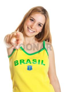Brazilian sports fan pointing at camera