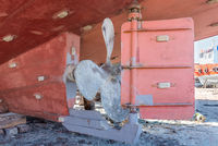 Metal propeller of ship on ground in old shipbuilding plant on coast
