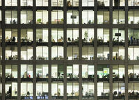 Modern office at night, showing the daily activity of office workers.