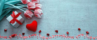 Valentine's day background with tulips and red heart on cloth Background.