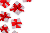 Gift white boxes with copy space. Festive packaging with red ribbons.