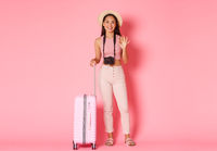 Tourism, summer vacation, holidays abroad concept. Full length of beautiful smiling girl traveller in hat, tourist with camera and suitcase showing thumbs-up, recommend hotel or destination
