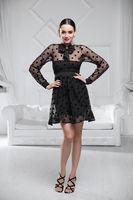 Beautiful woman wearing а black dress