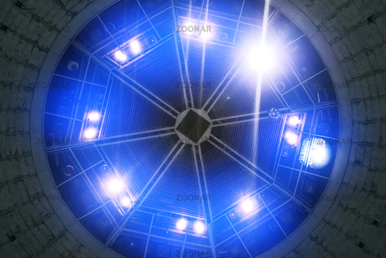 Light from blue spotlights shines from the roof of the concert hall. Stage lights. Bright lights. Event Poster Concept