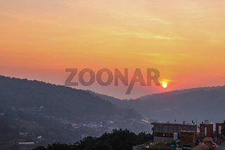 Colorful sunset over the mountain hills in a thai village near mountains in Chiang Mai