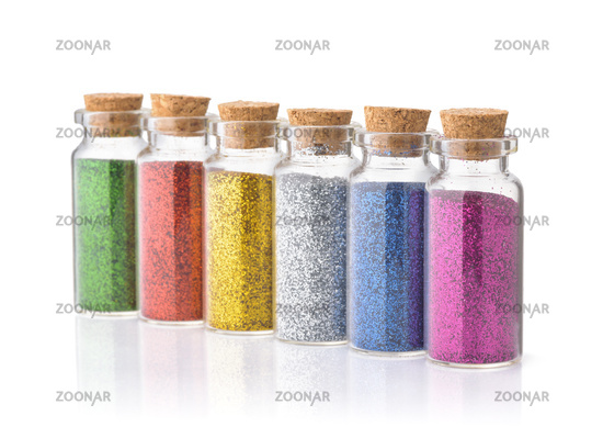 Row of colorful glitter bottles