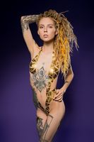 Sensual slim female with tattoos and stickers