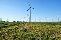 Backlit modern wind turbines seen in Germany