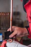 Craftsman works solder joints - close-up metalworking