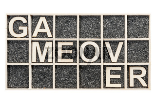 Wooden letters game over on sand