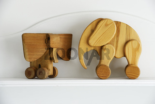 two wooden elephant sculptures