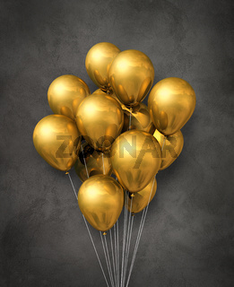 Gold air balloons group on a concrete background
