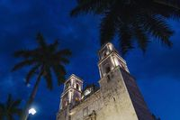 Church San Servacio with palm trees in the night in the downtown of Valladolid, Yucatan, Mexico