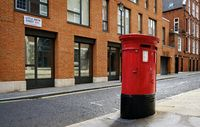 post box in london street with red houses