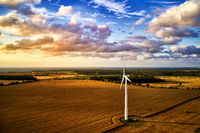 wind turbine power generator on a field in harmonic  mood atmosphere