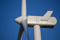 The top of a wind turbine across Nebraska farm lands