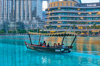Tourist boat inte pool of The Dubai Fountain