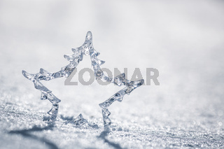 Silver Christmas star on snow
