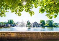Funny fountain in the river under the bright sun