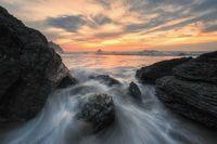 Evening Sunset at a Tropical Rocky Beach