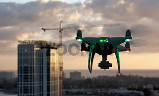 Unmanned Aircraft System Quadcopter Drone In The Air Near City and Corporate Building