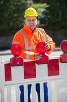 Worker checks the Construction Barrier