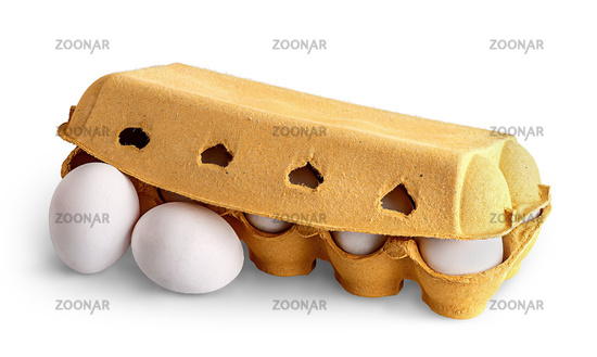 Closed egg tray and two eggs in front