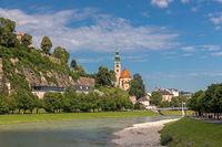 Muellner church at Salzach river, Salzburg, Austria