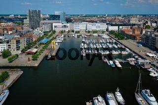 Yachts at the oldest harbor district Eilandje of Antwerp city - waterfront marina promenade, Belgium