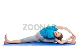 Yoga - young beautiful slender woman yoga instructor doing Revolved Wide Seated Forward Bend Pose (parivrtta upavistha konasana) asana exercise isolated on white background