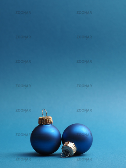 Blue vintage Christmas baubles on a blue background
