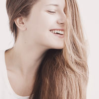 Positive beauty, closeup face portrait of young woman with long hairstyle and natural makeup look for female hair care, cosmetic or skincare brand