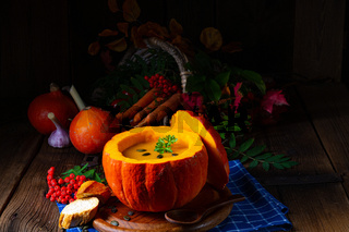 Delicious autumn pumpkin soup with baguette