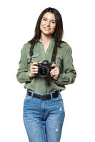 Female photographer reporter in jeans and a khaki shirt posing with a camera. Isolated on white.