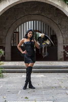 A Lovely Hispanic Brunette Model Poses Outdoors With A Caracara Bird At A Hacienda