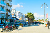 People walking promenade Larnaca Cyprus