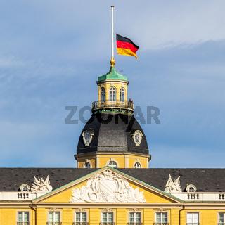 German Flag at Halfmast, auf Halbmast, on the top of Castle Karlsruhe. In Karlsruhe, Baden-Württemberg, Germany