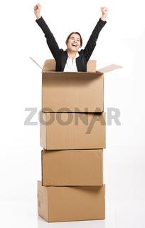 Business woman appear inside a big card box