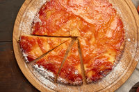 baked round apple pie on wooden board a