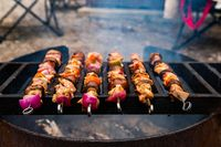 Grilling meat skewers on a barbecue