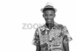 Young happy African man ready for vacation