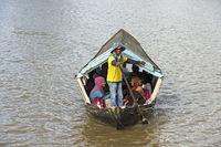 Sampan man in his ferry boat on Sarawak river, Kuching, Sarawak, Borneo, Malaysia